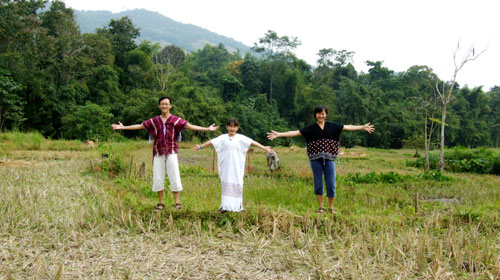 The Yongs at rice paddy of Tigerland Rice Farm